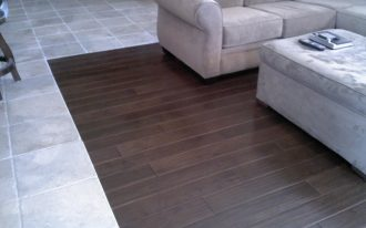 white-washed tiles to darker wood planks finishing floor transition a white furniture set for living room