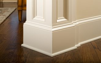 wide white baseboard style wood flooring with darker tone