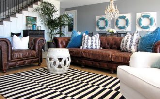 wonderful idea of living room with cozy brown leather sofa also alluring blue cushion with magnificent gray wall also mesmerizing stripes black and white rug with potted plan in the corner