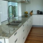 wonerful nice adorable fantastic adorable ashmere white granite with dark white concet and has nice glass design with marble look countertop