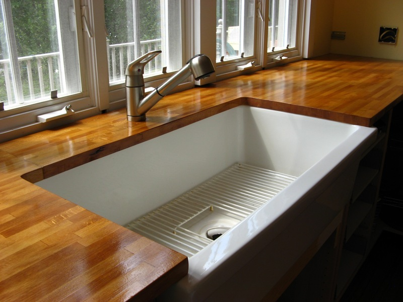 Wood Finishing Countertop Idea With Large Porcelain Sink In Square Shape And Metal Faucet