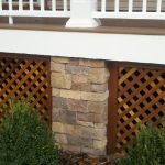 wood lattice porch skirting with brick wall porch-stand