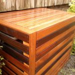 wood planks box for pool equipment storage with large air circulators