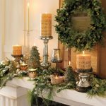 adorable-cool-nice-simple-luxurious-christmas-decoration-for-mantel-with-green-leaves-concept-and-nice-big-candle-decoration-728x655