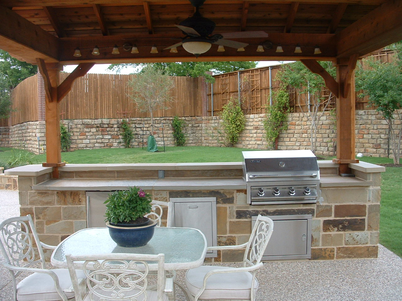 An Outdoor Kitchen Set With