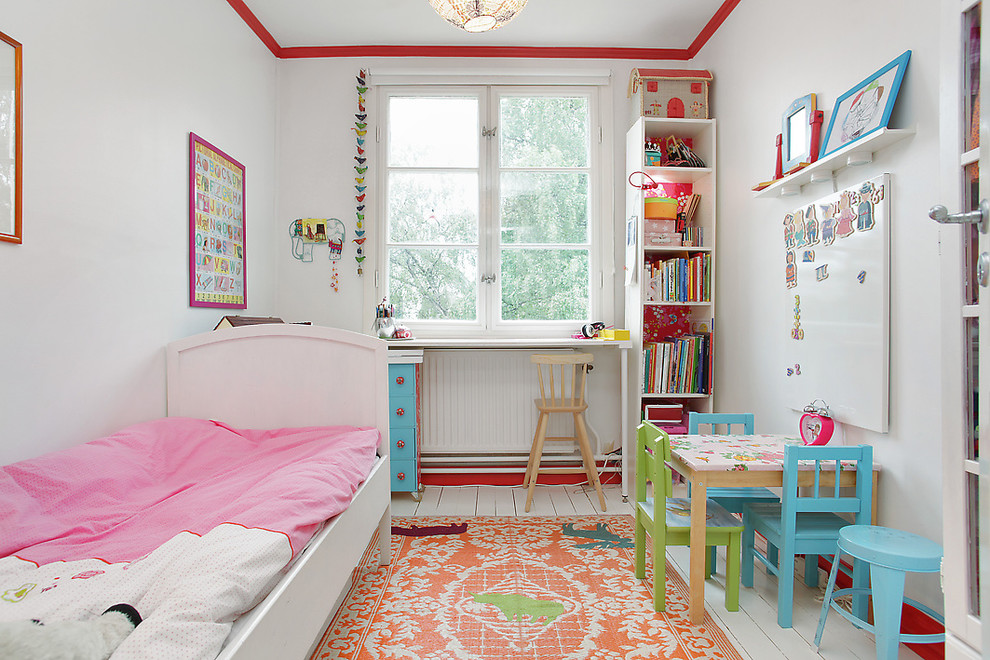 beautiful orange carpet with patterns for little girl bedroom a set of colorful chairs with small table a study desk with higher-legs wood chair vertical bookcase a white floating shelf for storage