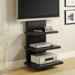 black floating TV console with under shelves without side-wall a flat TV set a pile of movie collections  DVD player