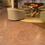 brown solid epoxy painting for basement floor a set of cozy and luxurious living room furniture with log tree legs table a round-shape carpet for living room