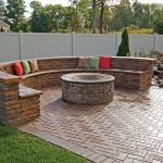 Built In Round Fire Table And Half Round Shape Seating Made From Bricks Some Colorful Pillows