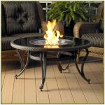 Classic And Luxurious Round Fire Table For Patio With Glass Surface  A Set Of Patio Furniture  Wood Planks Floors For Patio