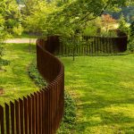 classic-unique-Backyard-Fence-Ideas-amazing-fence-design-close-to-with-Beautiful-privacy-fence-makes-landscaping-interesting-with-unique-shape-and-brown-wooden-colorng-with-green-grass