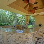 creative and unique ceiling fans brown marble outdoor kitchen island with chairs  several kitchen appliances