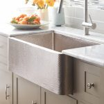 farm square-shape deep sink that is made from textured stainless steel a plate of fresh oranges stainless steel faucet