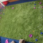 green-fresh-ikea-rug-kids-design-in-square-shape-with-comfortable-fur-in-green-furnished-by-several-colorful-flowers-around-its-edges-728x546