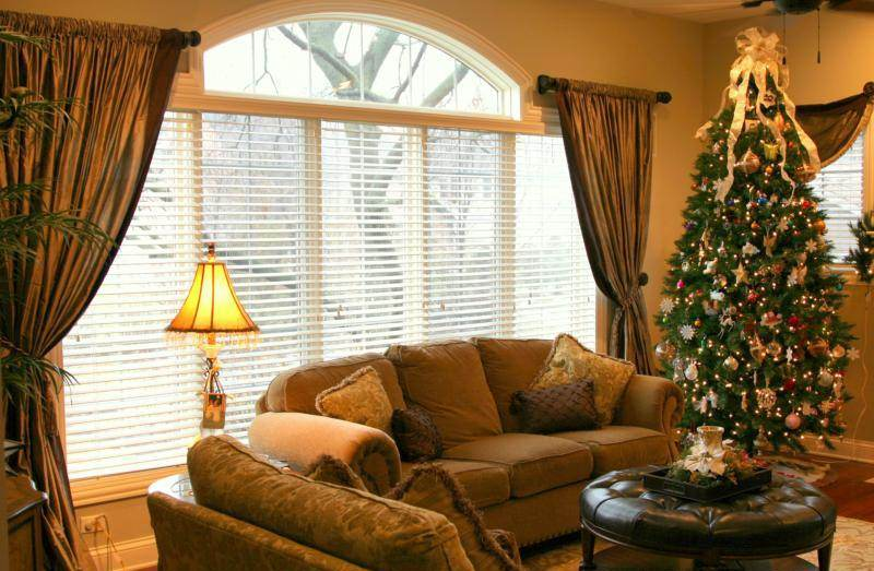 Large Arched Window With White Shutter And Gold Curtains As Window  Treatments A Big Christmas Tree