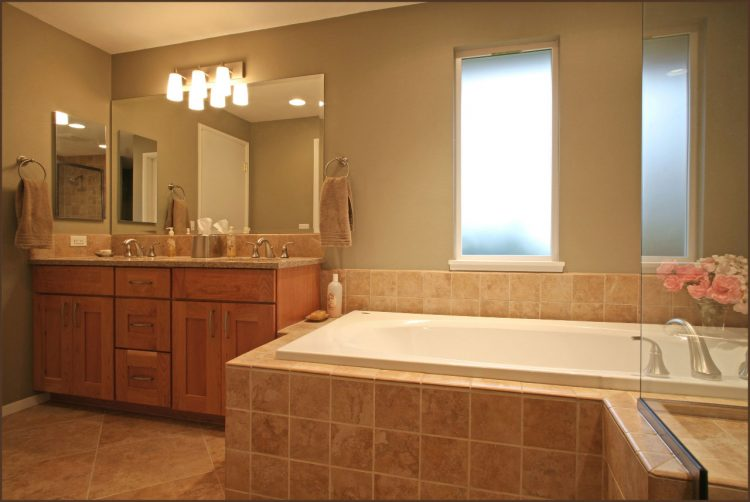 large bathtub with brown ceramic tiles wall system bathroom vanity
