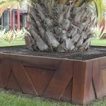 large concrete palm tree planter box