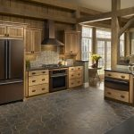 oil rubbed bronze kitchen appliances  in rusttic-style kitchen room natural stone tiles for kicthen floor