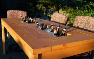 picnic table with ice container in the middle of table comfortable chairs for outdoor
