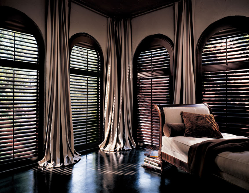 Pretty Dramatic Look Of Room With Several Arched Windows Dark Shutter Window  Treatment Dark Grey Floor