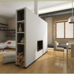 room partition end storage and fireplace unit that separates the dining room and living room