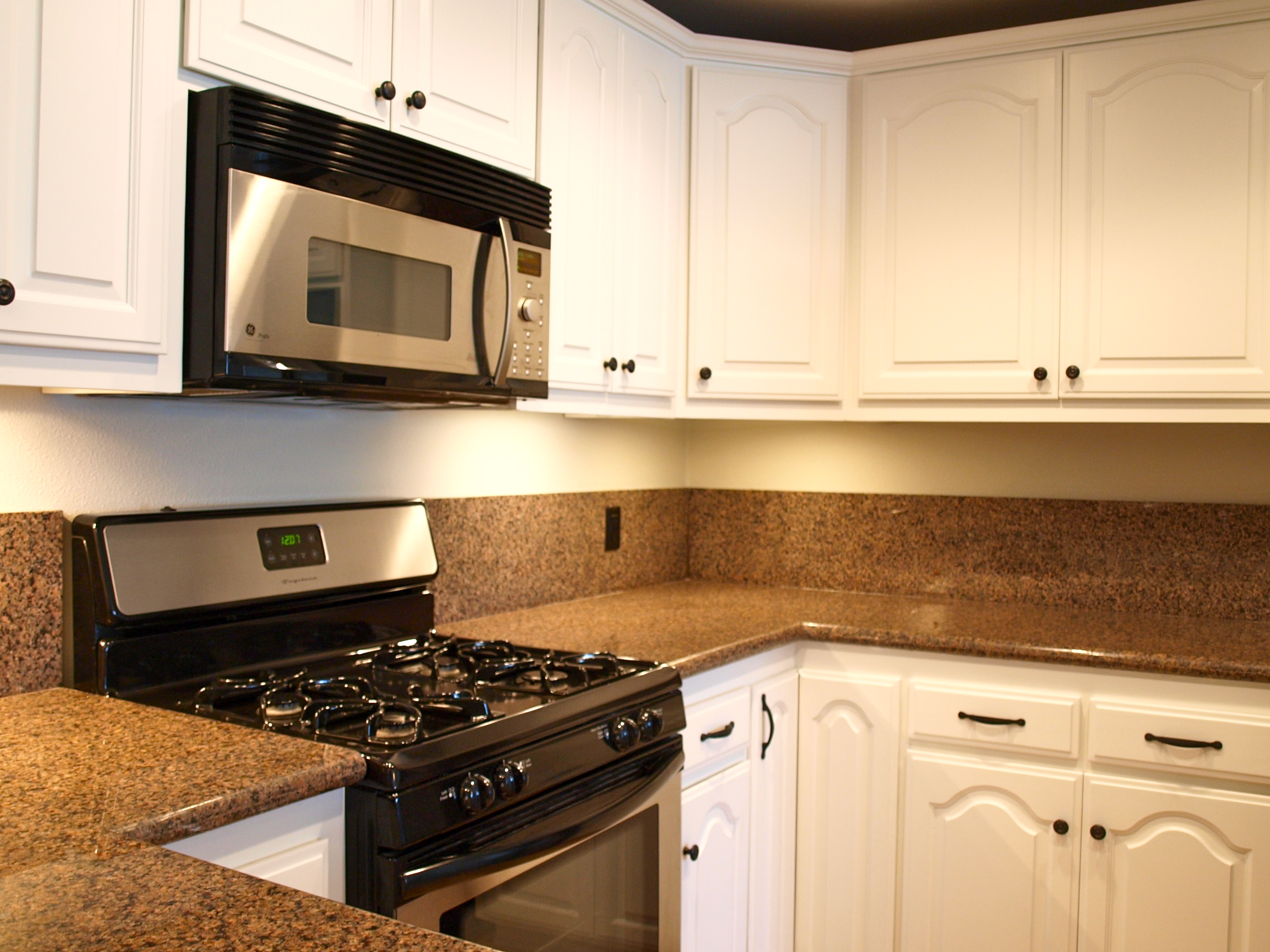 rubbed bronze kitchen appliances such as gas stove unit and oven brown