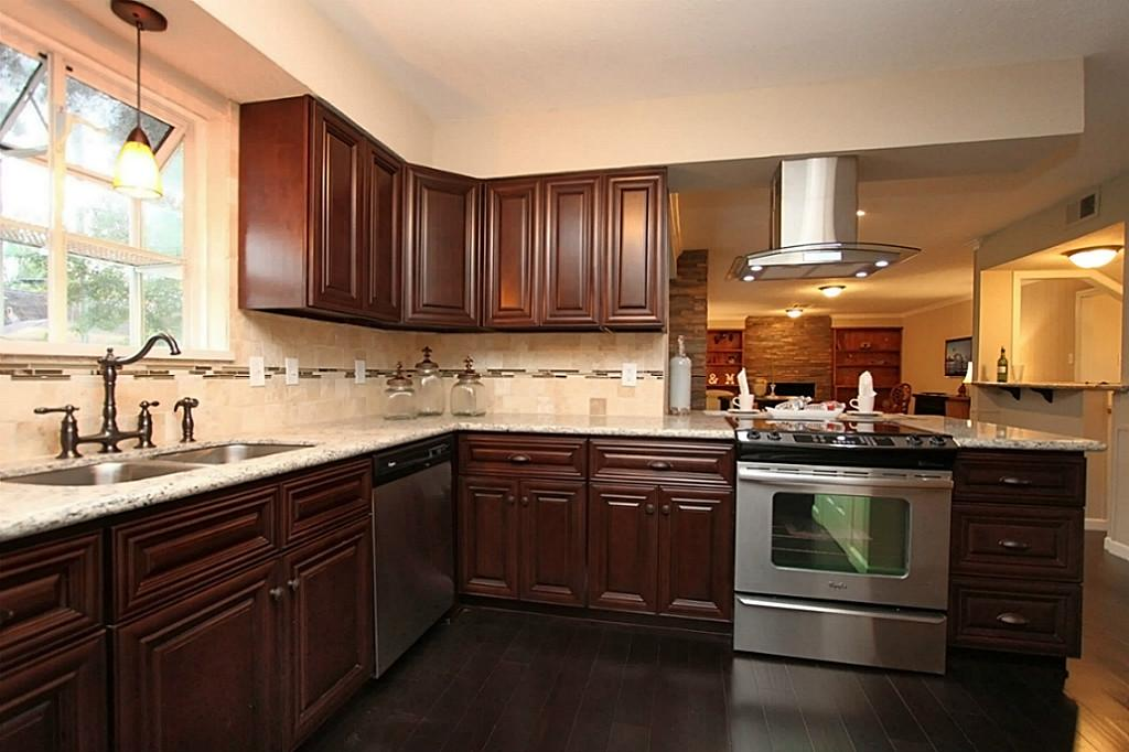 several rubbed bronze kitchen appliances in elegant kitchen room dark