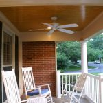 simple porch idea with some white rocking chairs and  white ceiling fan and also white-painted wood fence system