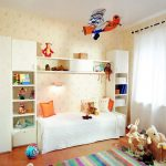 stripp-patterns carpet in multi-colors a storage furniture with bed in white color a lot of animal stuffs  and decorative stuffs