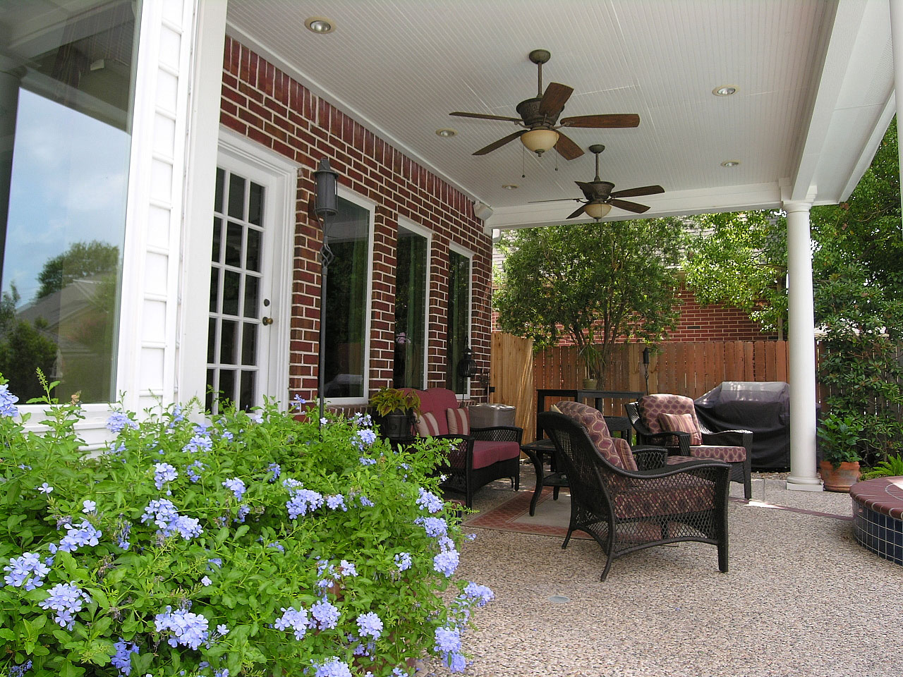 Twin Ceiling Fan Units In The Porch Luxurious Outdoor Furniture For Red Bricks Wall