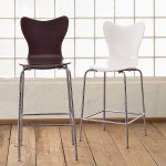 white and dark brown bar stools with back feature and metal legs