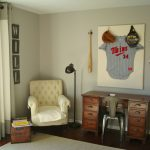 white corner chair for reading  classic black metal standing light fixture wood desk with chair white rug in wood floors baseball costume and baseball stick some baseball equipment small wall-lamps