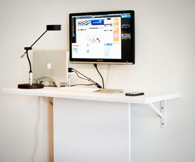 white floating standing desk for monitor a big flat computer screen a unit of laptop
