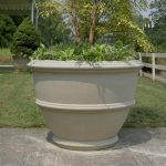 wonderful-big-large-awesome-classic-concrete-planter-boxes-with-big-high-round-shape-conceot-woth-nice-design-for-big-plant