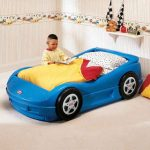 Wonderful Cool Adorable Nice Simple Plastic Made Blue Race Car Beds For Boys With Real Wheels Look Small Concept With Yellow Bed Sheet