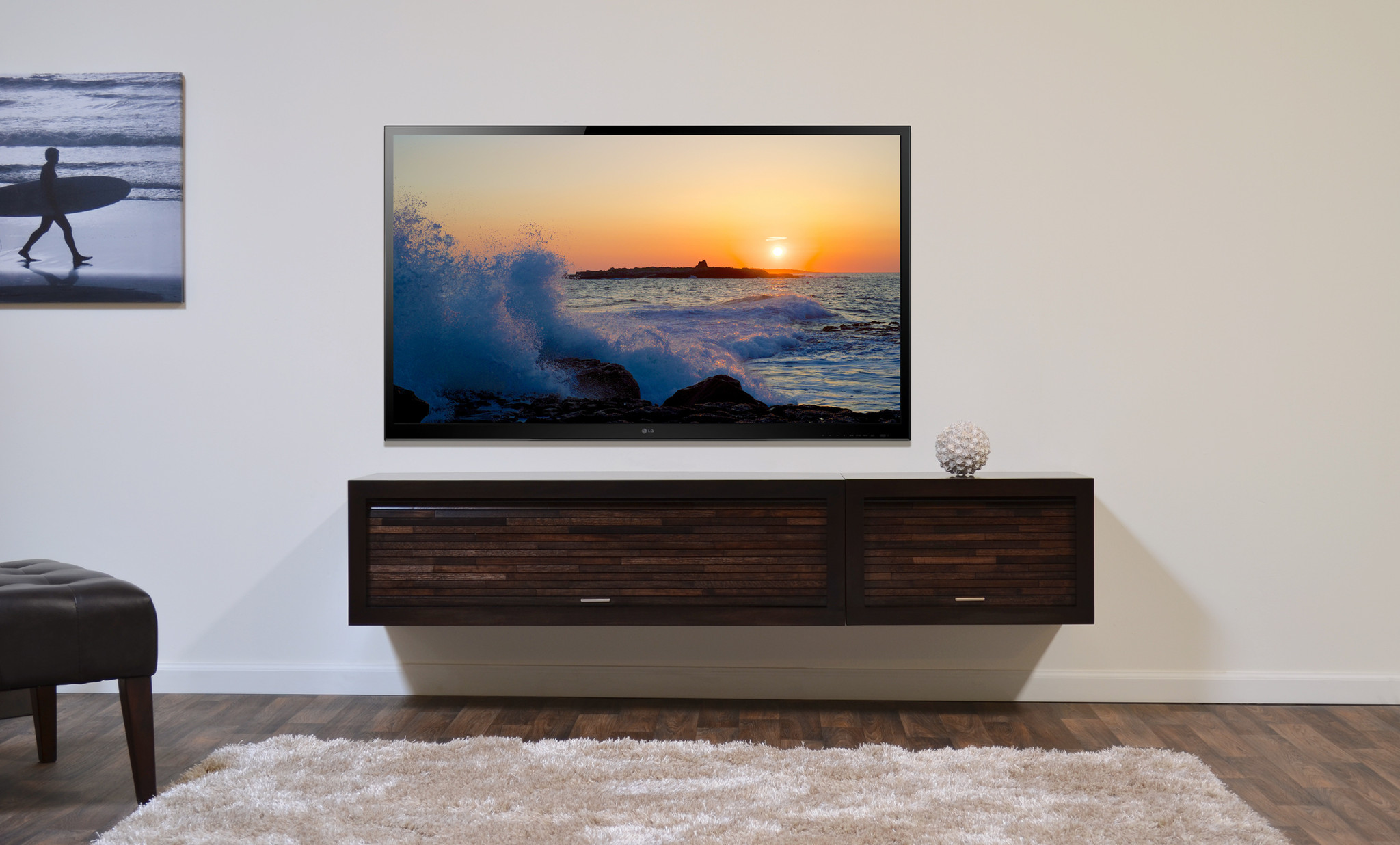 Wood Floating Tv Console With An Ornamental Ball And A Large Flat Screen No Color