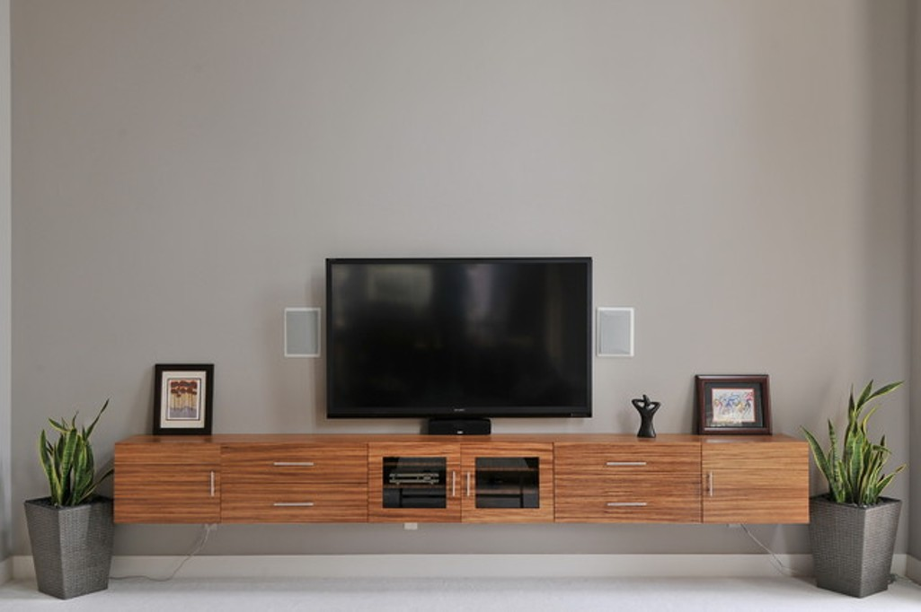 Floating media console a way to display your tv with pride homesfeed for Floating tv stand living room furniture