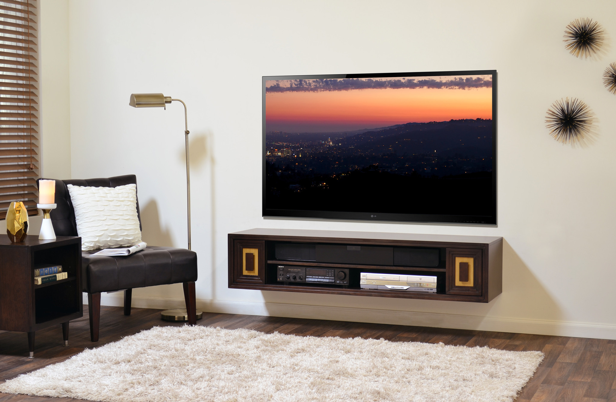 wood floating media console with shelves DVD player sound system flat TV a  single black chair