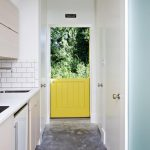 Bright yellow Dutch door in one is opened and  another is closed