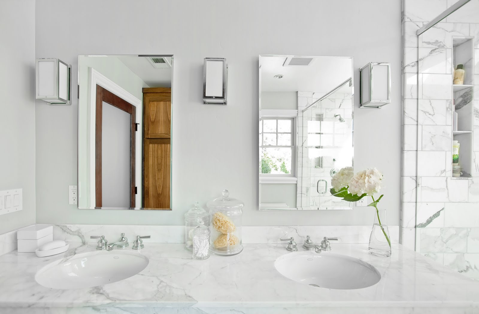 carrara marble vanity with deep sinks and stainless steel faucets a pair of frameless mirrors three - Bathroom Ideas Marble