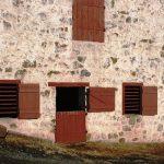 Dutch door in barn door style in a farmhouse that is taken in 1700s