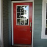 Fullview storm door with half red wood panel