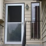 Pella's rolscreen storm door with transparent glass panel