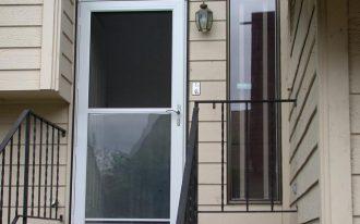 Pella's rolscreen storm door with transparent glass panel