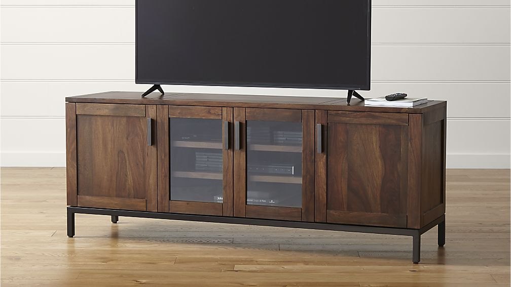 A Media Console With Centers Glass Door Cabinet For Organizing The Items  Inside And Other Two