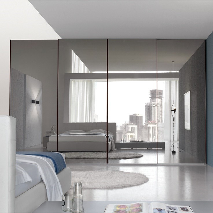 a modern minimalist bedroom design with extra wide frameless wall mirror a  king bed furniture a. Floor to Ceiling Mirrors as Functional and Decorative Interior