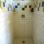 adorable color tile backsplash combined with white tile wall and floor in narrow bathroom with walk in showers designs
