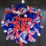adorable fourth of july wreath design in blue color with american flag ribbon decoration with stars and spelling of happy fourth of july
