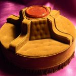 adorable golden yellow velvet round settee design with tufted backrest and brown center with sectional mode on purple flooring idea