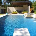 adorable large and long swimming pool shape with concrete deck in narrow and minimal style before a wondrous outdoor terrace aside lush vegetation